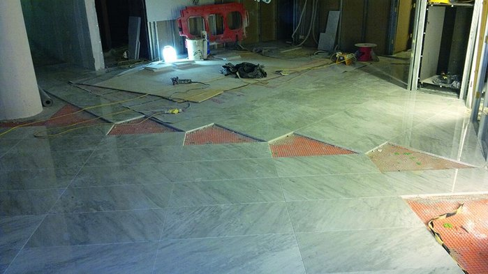 Laying out the floors in lobby areas. Setting out lines are drawn from the tip of the atrium triangle through the centre of the vestibule ellipse
