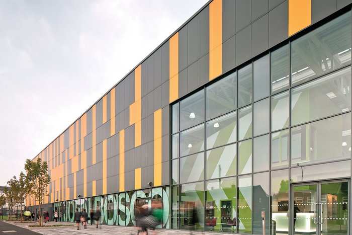Exterior of St John Bosco Arts College, which delivered 15% more space through the use of its simple big box structural concept.