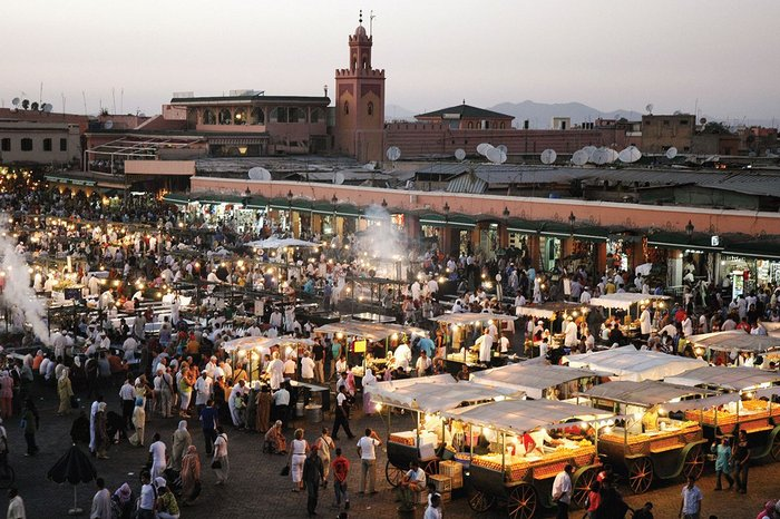 People-watching in the night market in the Djemaa el-Fna, Marrakech. Deeper insight into sites  and human behaviour is increasingly possible from data.