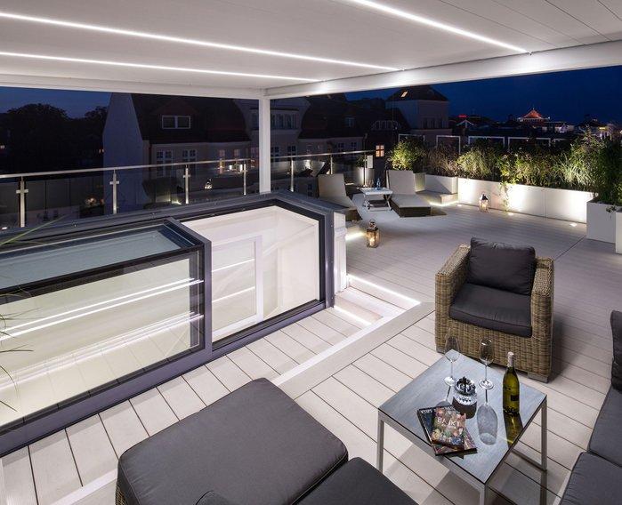 Glazing Vision Europe's three-wall boxlight increases functionality at the Taras Na Fali apartments in Poland.