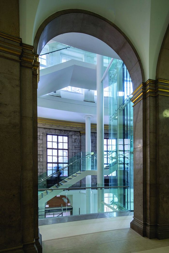 Gold leaf and Portland stone lead to the glass and steel of the vertical circulation core.