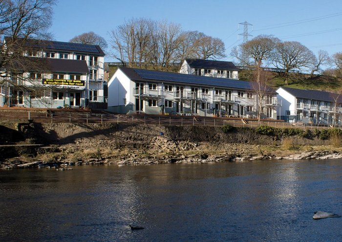 The Co-Housing development takes full advantage of its riverside location, with shared green spaces running down to the river bank.