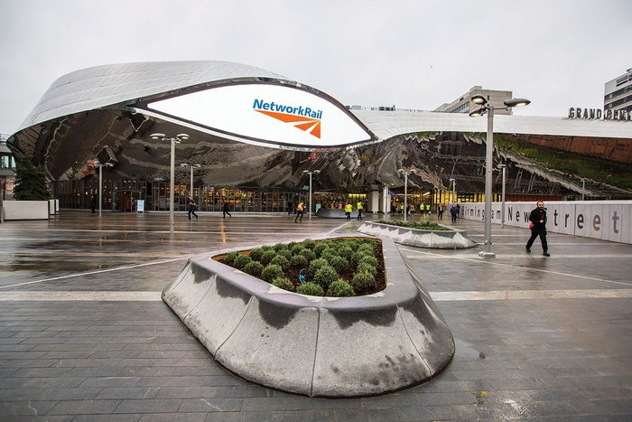 A paved square at the new east entrance is overlooked by one of the digital 'eyes'