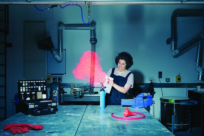 Making flames:  Zoe Laughlin introduces strontium chloride in methanol to a blowtorch.