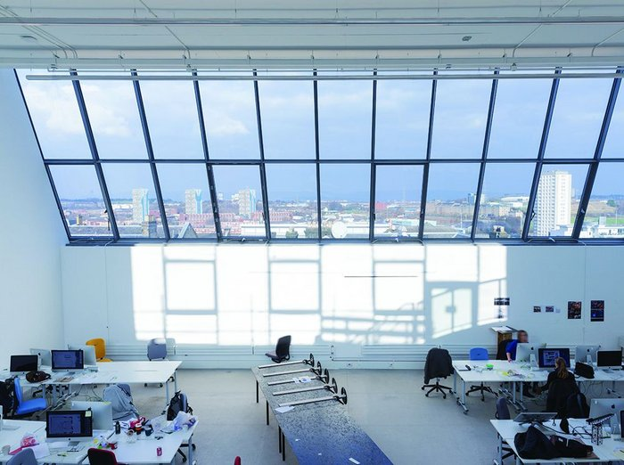 North light and south light, captured from the mezzanine of one of the sixth floor studio spaces. The height of the building on top of a drumlin means it teeters on the edge of the city centre with amazing views out north.