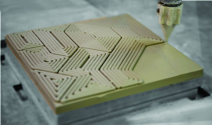 Ceramic tile being 3D printed by a robotic arm at Grymsdyke Farm for the Victoria and Albert Museum shop.