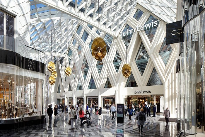 The diagrid roof and patterns of the arcade are given more expansive expression in the cladding on the John Lewis store.