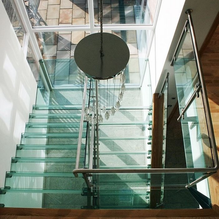 A Canal Engineering stair with glass treads and glass balustrades