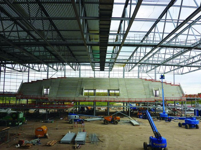 The main auditorium seating is positioned at the south of the arena.