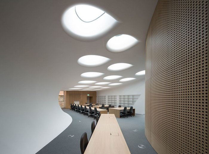 The library with its 'soft' ceiling and teardrop skylights.