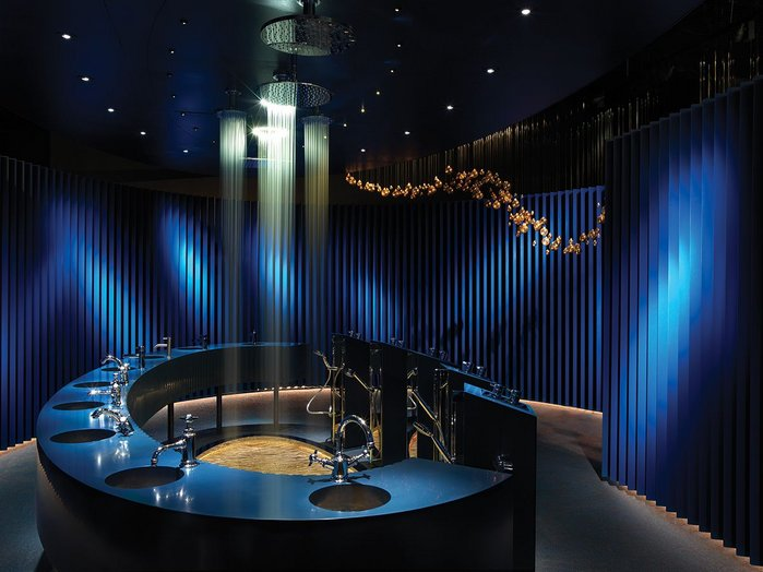 Terminating the showroom is a darkened egg-shaped space where visitors experience a showering light show.