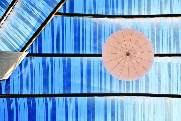 One of the outsize lights that add a luxury to the giant space of the atrium.