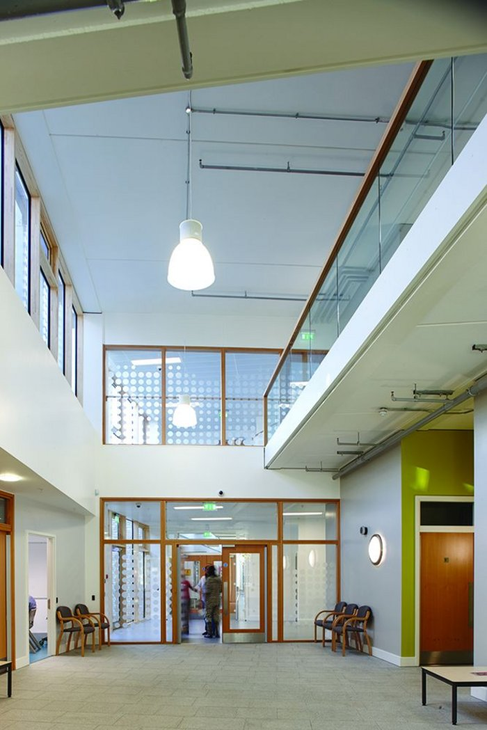 Double height spaces in the foyer and at the knuckle of the building bring in light and give it a lift.