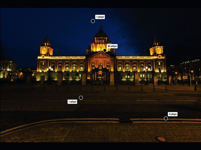 Belfast City Hall as currently illuminated. The frieze is invisible, the balustrade over-lit and the grand copper cupola is lost in darkness. The luminaire meter guns employed can give 'point' values