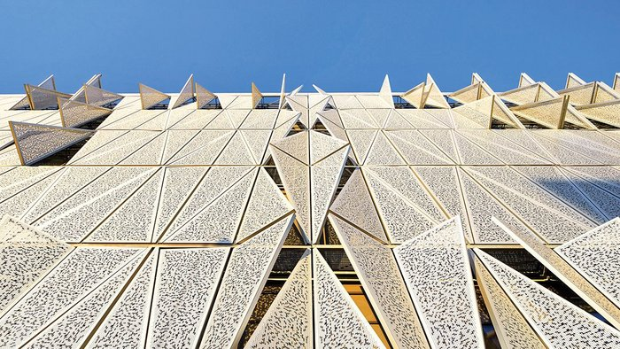 Responding to the sunlight, Henning Larsen's moving facade creates a butterfly effect for the building.
