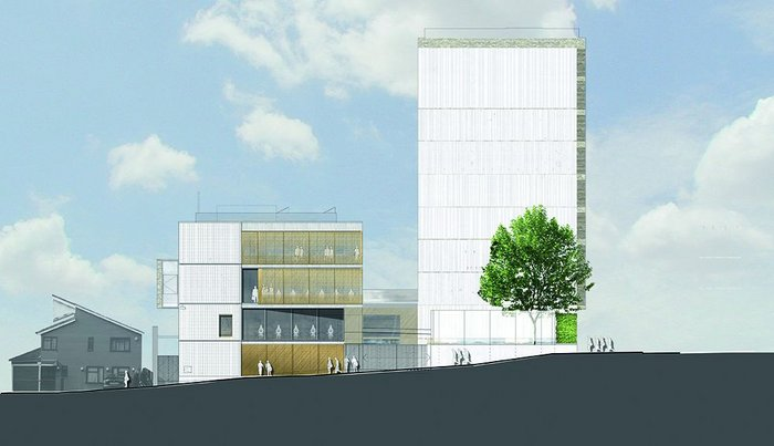 The east elevation of the community centre and flats: the exterior uses industrial materials