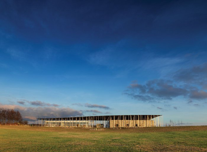 The visitor centre is conceived as an undulating roof sheltering glazed (left) and structural insulated panel-clad (right) pods.