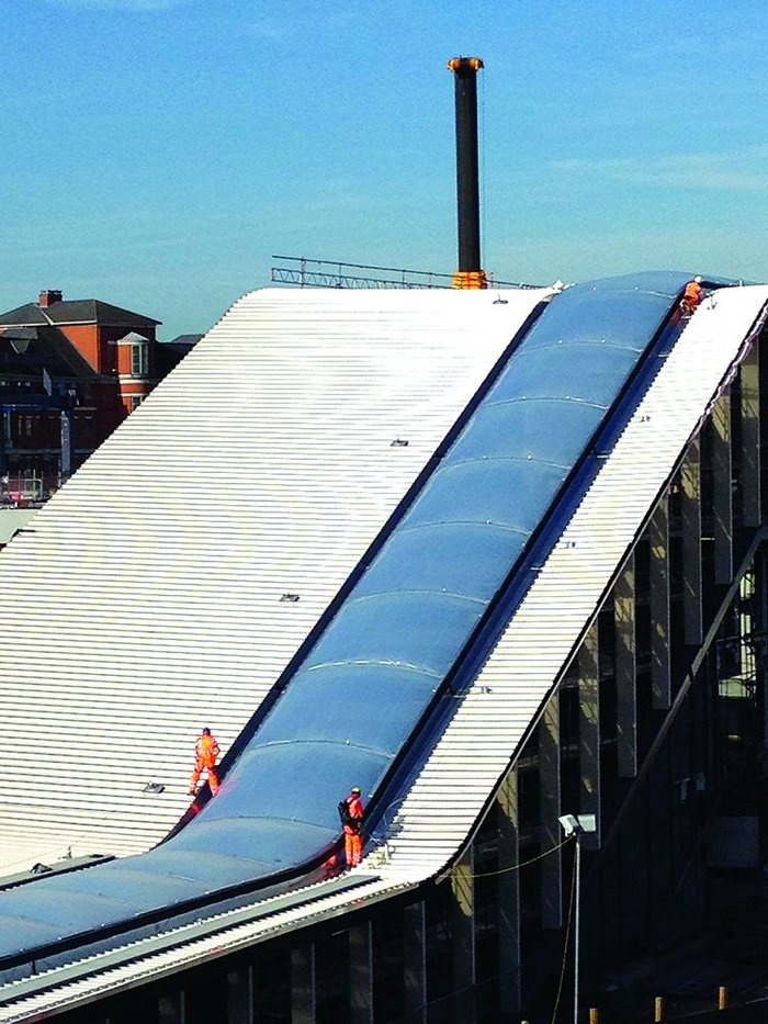 The steel standing seam and ETFE  roof give direction to the structure.