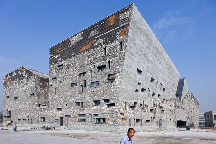 Ningbo Museum, Zhejiang Province, China by Amateur Architecture Studio. The form is inspired by the mountains and ravines of the surrounding area.