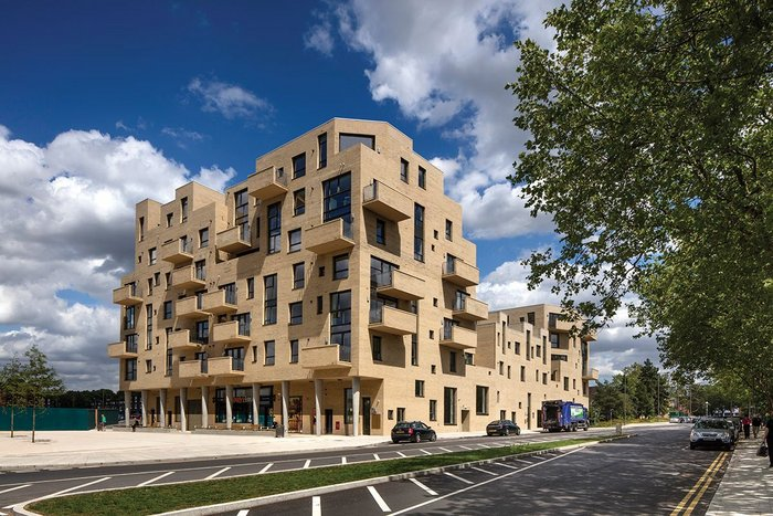 Peter Barber's newly completed housing for private sale is part of the first phase of the Grahame Park redevelopment and forms the eastern side of the new southern gateway square.