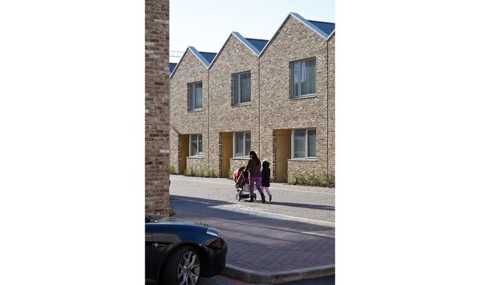 After exuberant work in the town centre this social housing creates modest new streets for Barking.