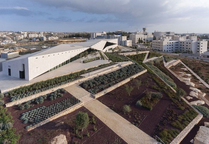Looking towards the west elevation of the Palestinian Museum, the building manifests itself as an element in a much wider landscape.