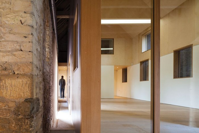 Extended and autonomous, Pod Gallery's timber structure is distinct from the barn walls and roof.