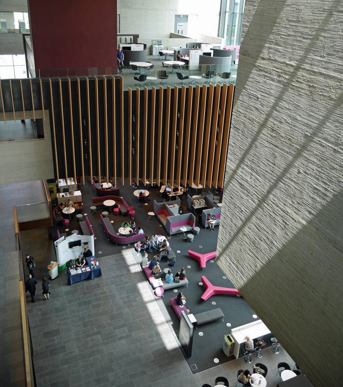 Looking down from the library wing past the hanging lecture theatre to the student forum far below.