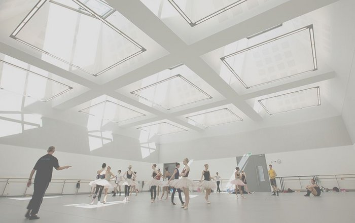 Main ballet rehearsal space, lit by nine west-facing rooflights designed to admit as much light as possible without causing visual distraction.