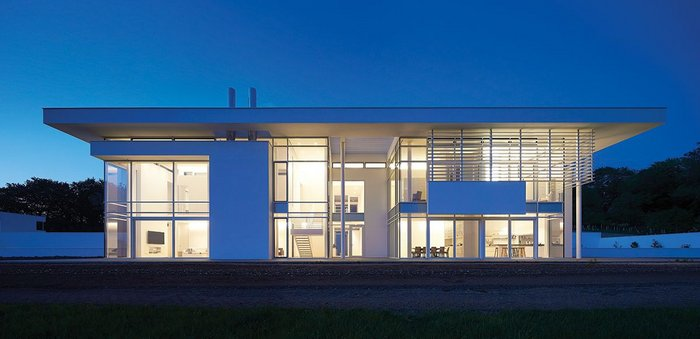 Full height curtain walling and sliding doors create a spectacular glazed main elevation.