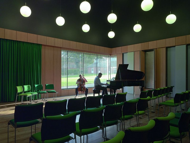 The recital hall with panels open to soften the acoustics. The view to the quad beyond means the musicians don't have to be cut off from the rest of the life of the school.