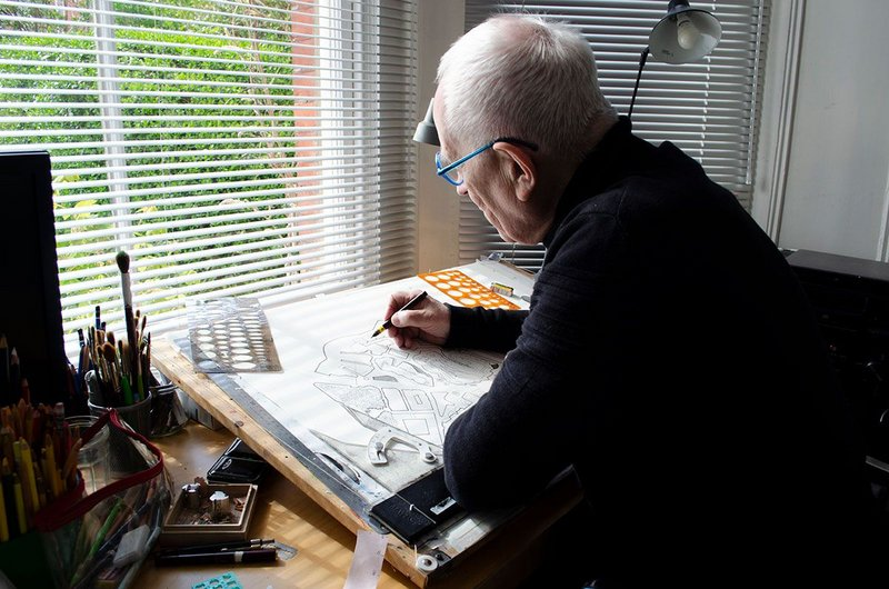 Peter Cook at his drawing board in the bay window of his front room.
