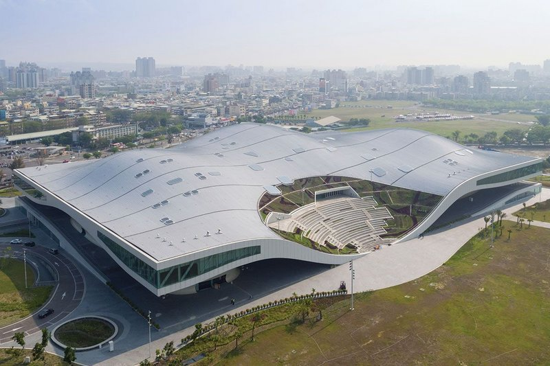 Southwest elevation of the complex showing the park-facing amphitheatre. The 35,000m2 standing seam roof covers the Banyan Plaza, four music halls, lobbies and all their support and admin spaces.