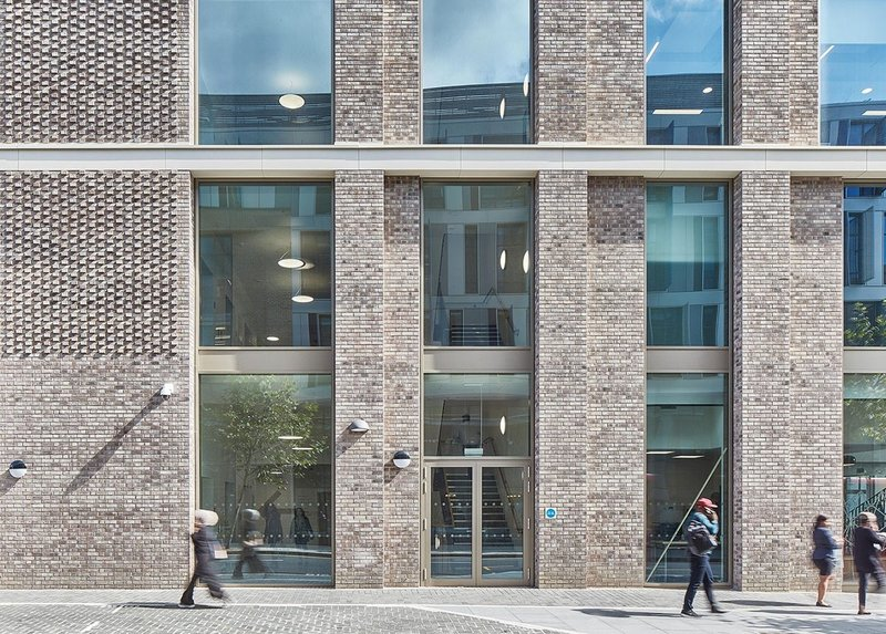 The brickwork facade with protruding header details at Colindale Offices in Barnet.