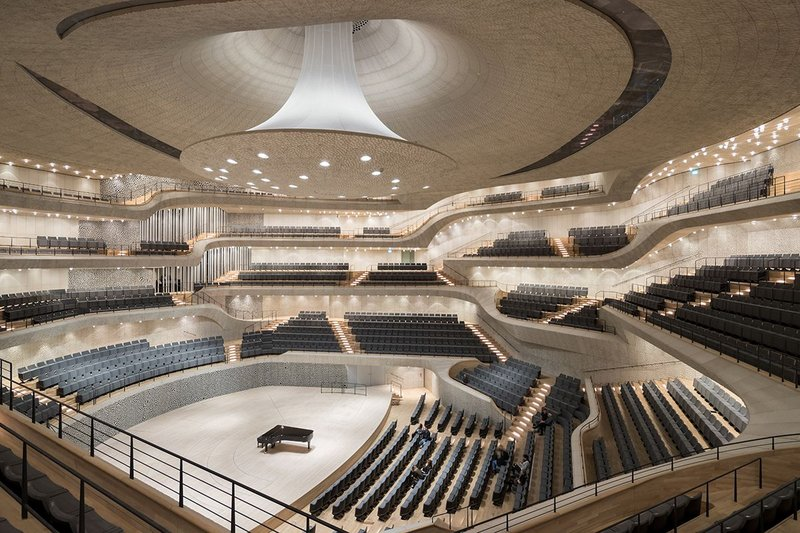 With its interconnecting levels and 10,000 coral-like acoustic panels and organ, centre right, the 2,100 seat main hall is highly impressive, despite its restraint.