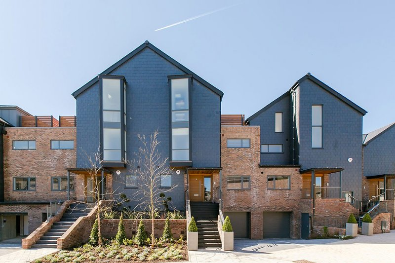 SSQ natural slate cladding at Chandlers Wharf, Lewes. The distinctive faintly rippled riven texture, deep blue-black colour and longitudinal grain make for distinctive buildings.