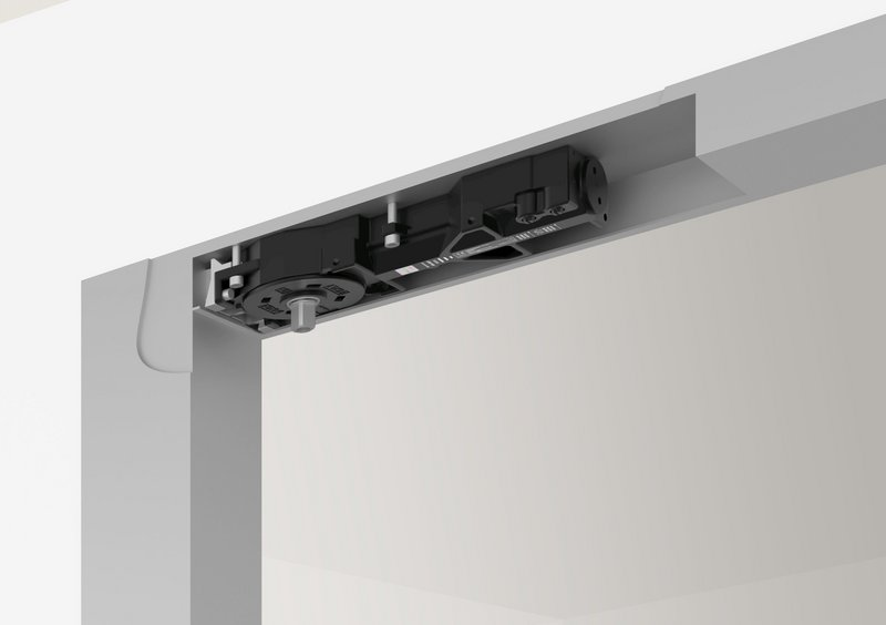 The DC6113 slimline transom door closer: Striking the balance between the closing of a door to keep a building safe and secure and making it accessible and inclusive to all.