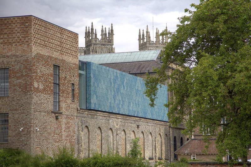 Facing the ruins of Museum Gardens with York Minster beyond, the ceramic wall is the outward sign of the reworking.