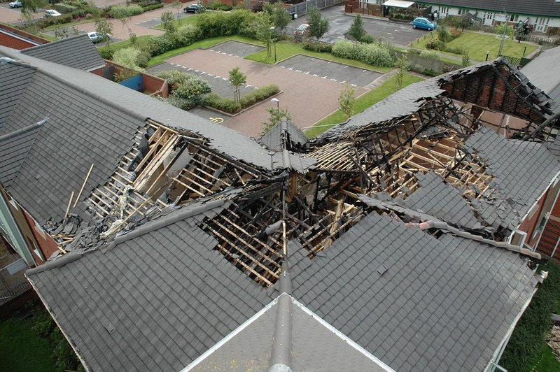 Aerial view showing damage to roof structure.