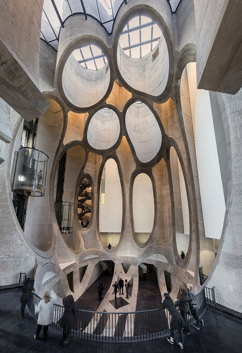 Carving out the 27m high site area has created a dramatic organic space reminiscent of Gaudi's work.