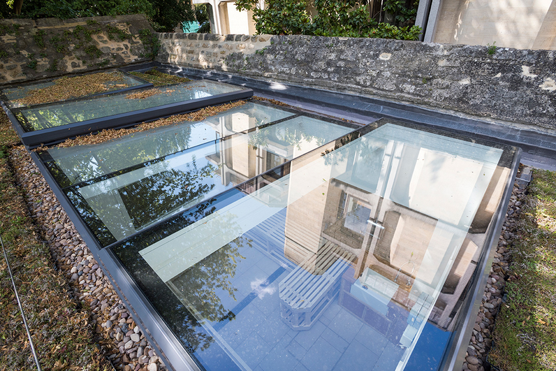 Sunsquare rooflights in the gardens of St John's College Oxford. A large part-fixed, part-opening rooflight allows light into darker areas.