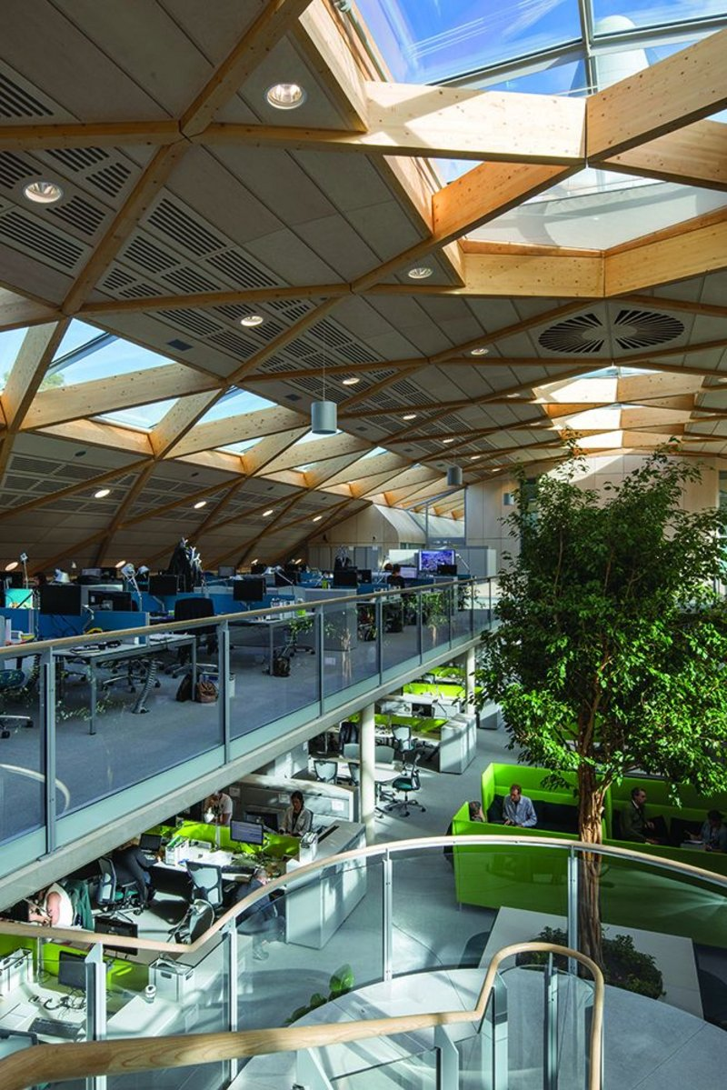 Phase change material and concrete help the thermal atmosphere almost invisibly while rooflights, nicely configured vents to the wind cowls and hefty indoor trees bring another sort of life to the office.