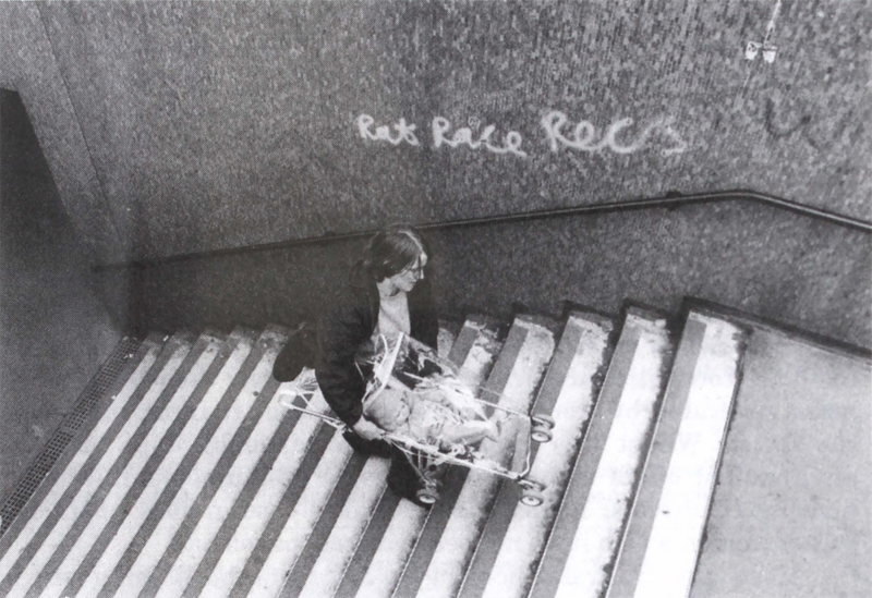 Matrix founding member Anne Thorne carries a pram up the steps of a subway in Aldgate, East London from 'Urban Obstacle Courses' in Making Space: Women and the Man-Made Environment (Pluto Press, 1984). Source: Christine Wall. From How We Live Now at the Barbican- Reimagining Spaces with the Matrix Feminist Design Co-operative project.