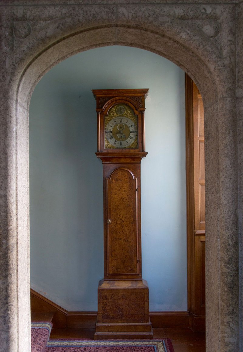 The quiet echoes of a clock ticking.