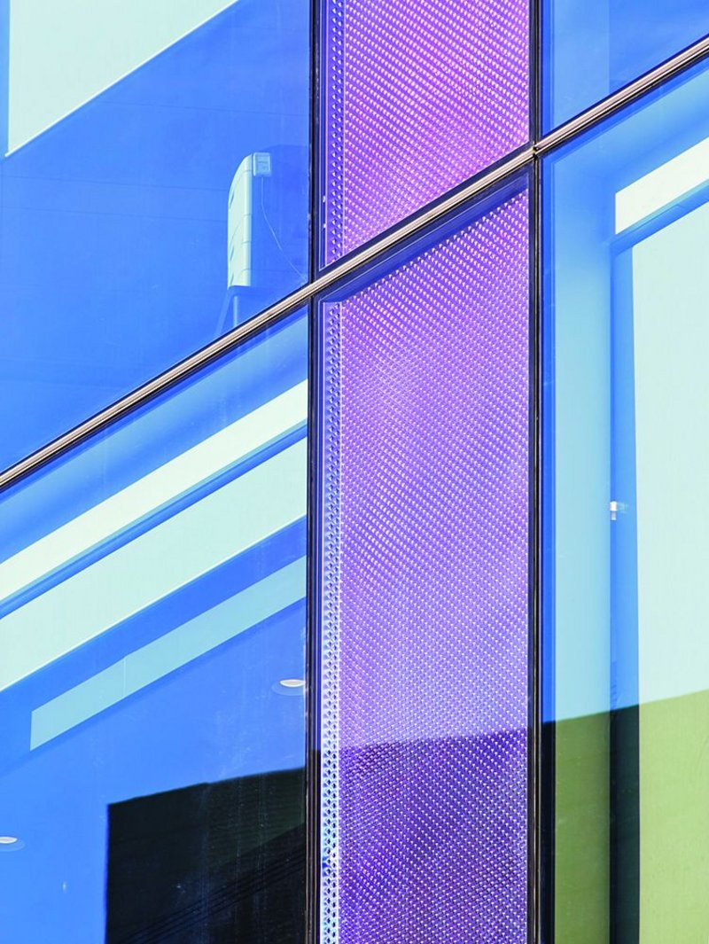 Solid elements introduced into the all-glazed facade allowed the building to meet Part L regulations without a wholesale redesign.