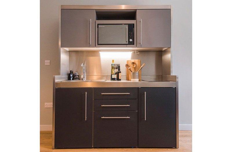 Elfin's Premium Bespoke range brings wall units, appliances, storage, sink, worktop and splashback into one space-saving unit.