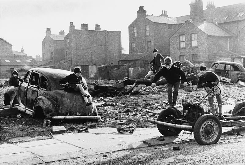 Manchester, 1968 [image of children in abandoned cars] by Shirley Baker.