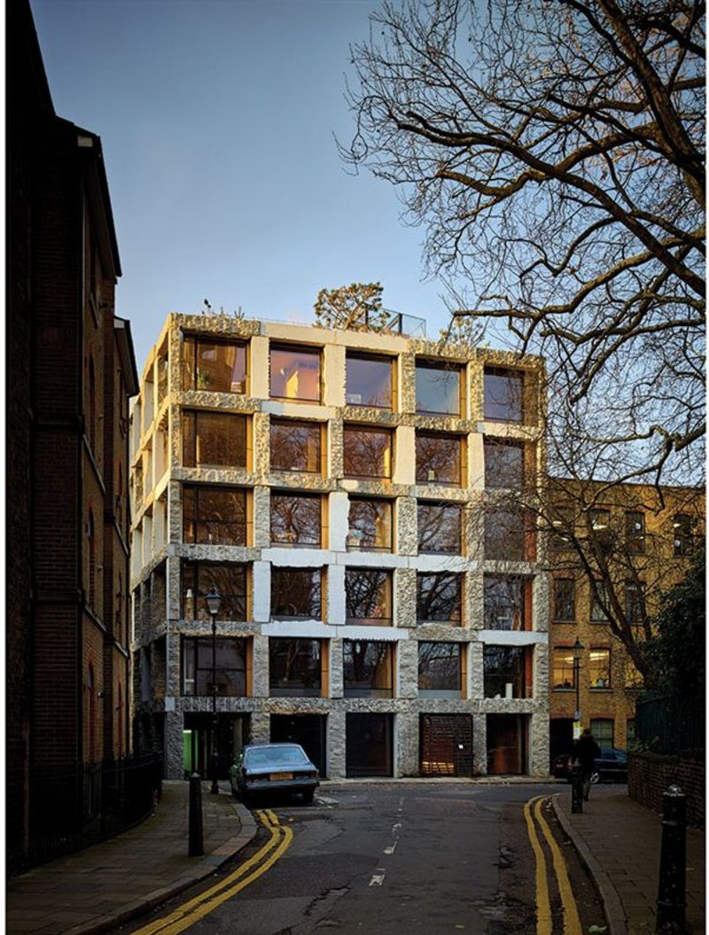 The main east elevation of 15 Clerkenwell Close shows the curious limestone exoskeleton with its various surface treatments.