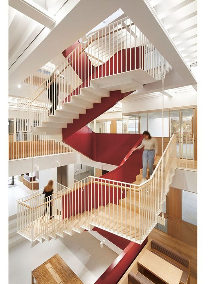 The red-painted steel ribbon stair is the unifying element of Piercy&Co's refurb and upgrade.