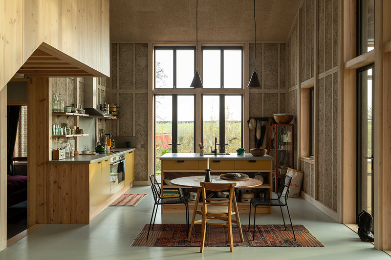 Flat House, a low embodied carbon house in Cambridgeshire designed by Practice Architecture. The project prototyped prefabricated hemp fibre cladding.